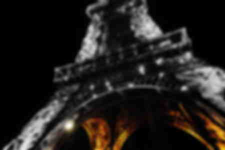 the eiffel tower at night illuminated in Paris France