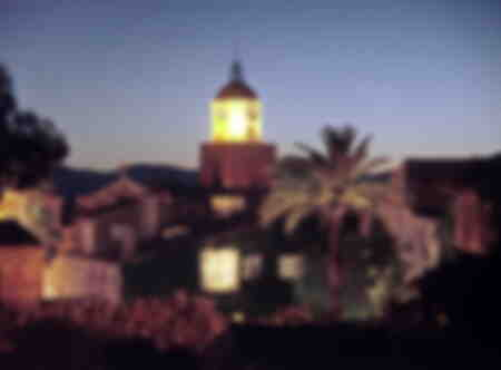 the bell tower of Saint Tropez seen at night, illuminated
