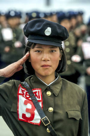 YOUNG WOMAN FROM THE NORTH KOREAN ARMY