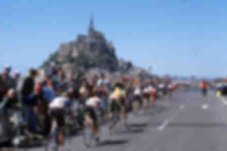 The riders of the Tour 1990 pass in front of the Mont Saint Michel