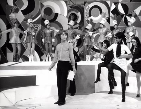 Claude François surrounded by dancers