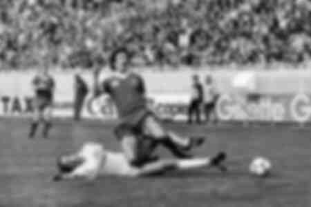 David Johnson is tackled by Uli Stielike during European Cup Final in 1981