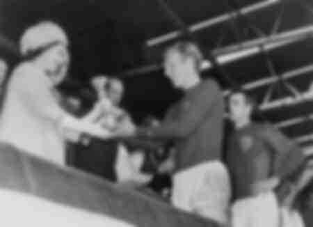 Queen Elizabeth of England presents the Cup to Bobby Moore