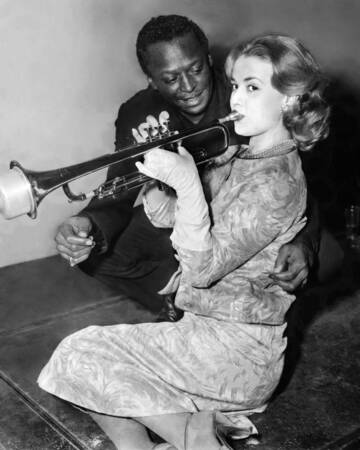 American Jazzman Miles Davis gives trumpet lesson to French actress Jeanne Moreau