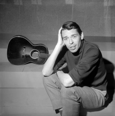 Jacques Brel on a TV set