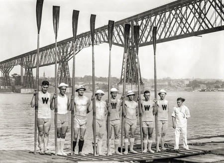 Wisconsin rowing team pose in front of Hudson river
