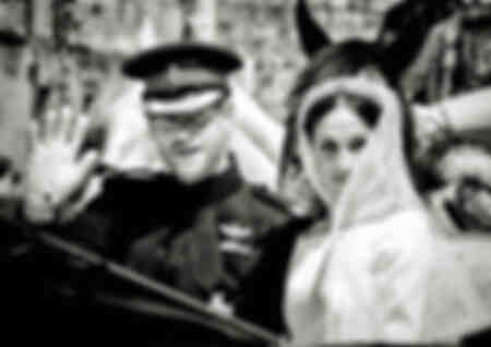 Prince Harry and Megan Markle during the royal procession through Windsor