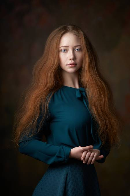 Portrait of a redheaded girl in green
