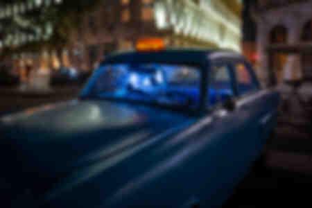 An empty blue taxi in Havana