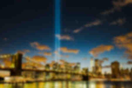 Manhatta with Brooklyn bridge and 9-11 lights