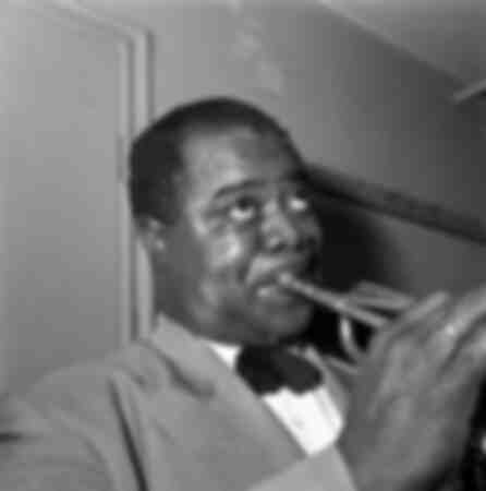 Louis Armstrong playing the trumpet 1952