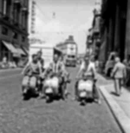 American tourists on Vespas in Rome Italy in 1958