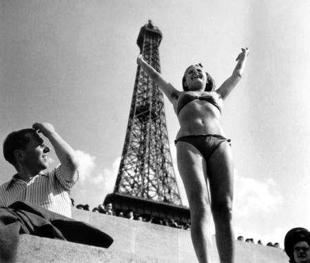A young woman in front of the Eiffel Tower in 1945