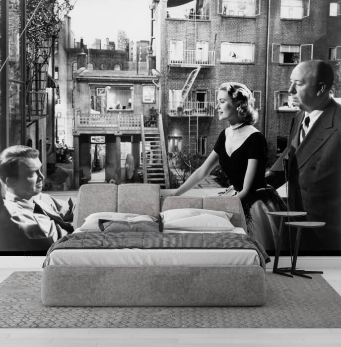 Grace Kelly between James Stewart and Alfred Hitchcock
