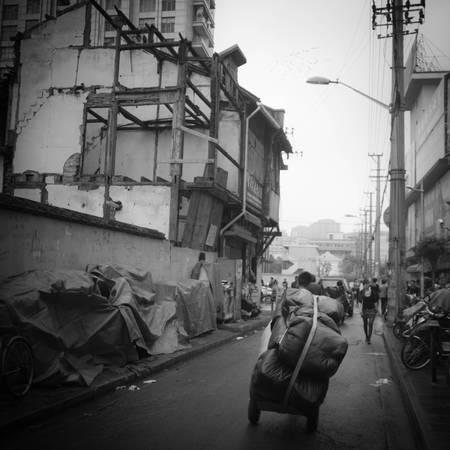 SHANGHAI MAN PUSHING A BIG BALLOT