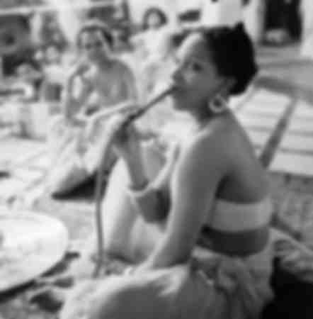 Woman smoking hookah in Algeria