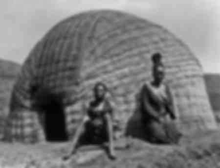 Zulus in front of a hut 1937