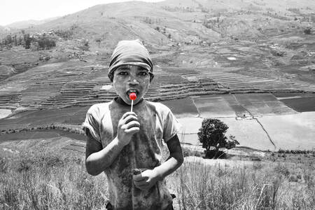 The boy with red lollipop