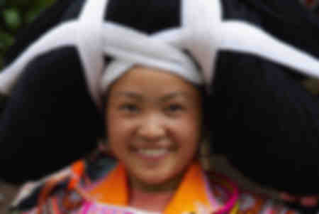 Long Horn Miao girl in traditional costume