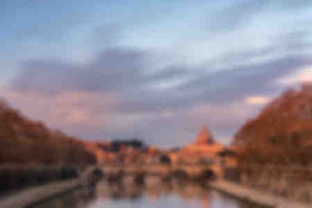 St Peter's Basilica and river Tiber in Rome Italy