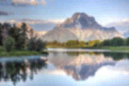 Water reflection of Mount Moran