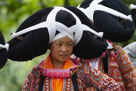Long Horn Miao girls in traditional costumes