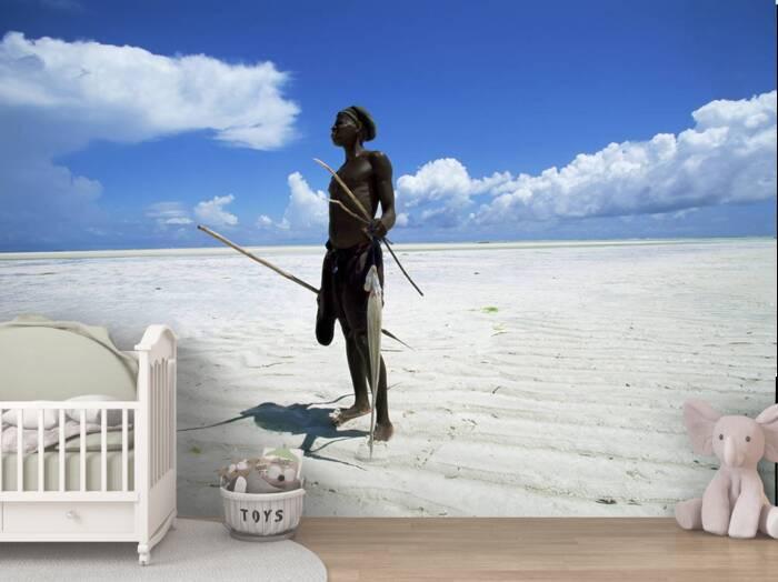 Fisherman on beach Zanzibar