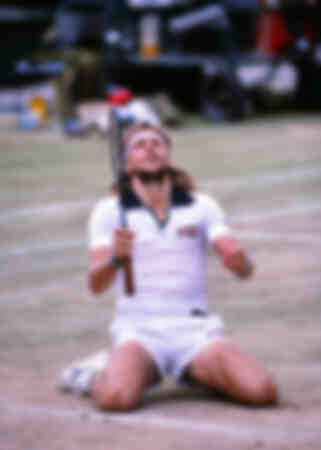 Bjorn Borg sinks to his knees after defeating John McEnroe