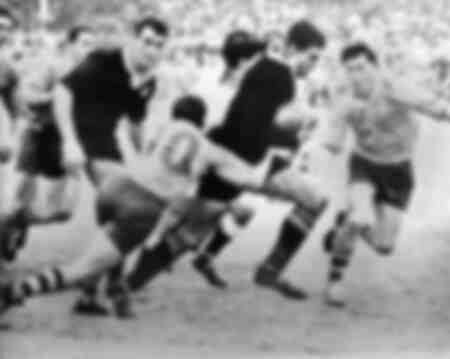 Colin Meads runs at Hugh Rose
