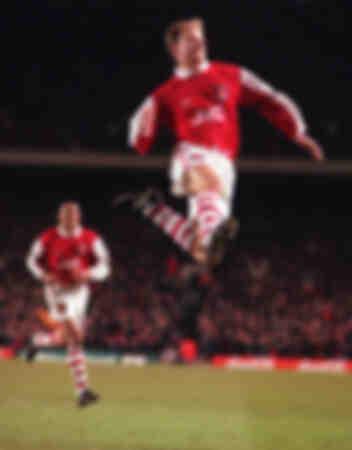 Dennis Bergkamp celebrates his goal