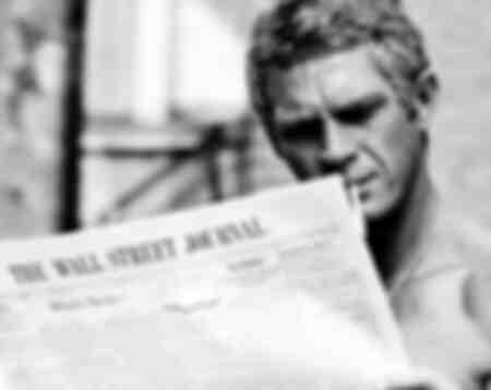 Steve McQueen reading the Wall Street Journal