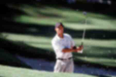 Tiger Woods during a bunker strike in 2001